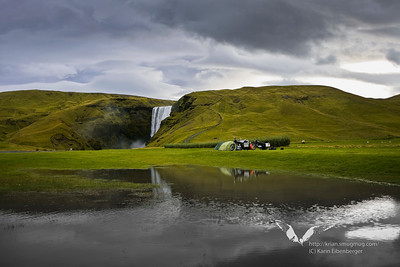 Campground in front of a waterfall in south Iceland.